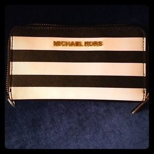 Michael Kors black and white striped wristlet
